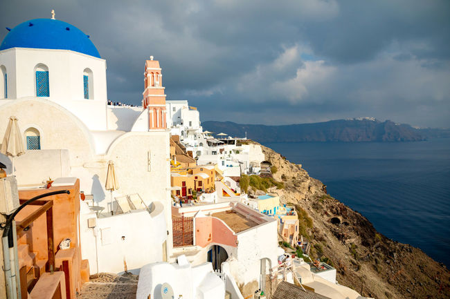 Greece Santorini Oia Thira Architecture Building Exterior Built Structure Building Sea Religion Cloud - Sky Water Sky Place Of Worship Nature Spirituality Belief Dome City Day High Angle View Outdoors
