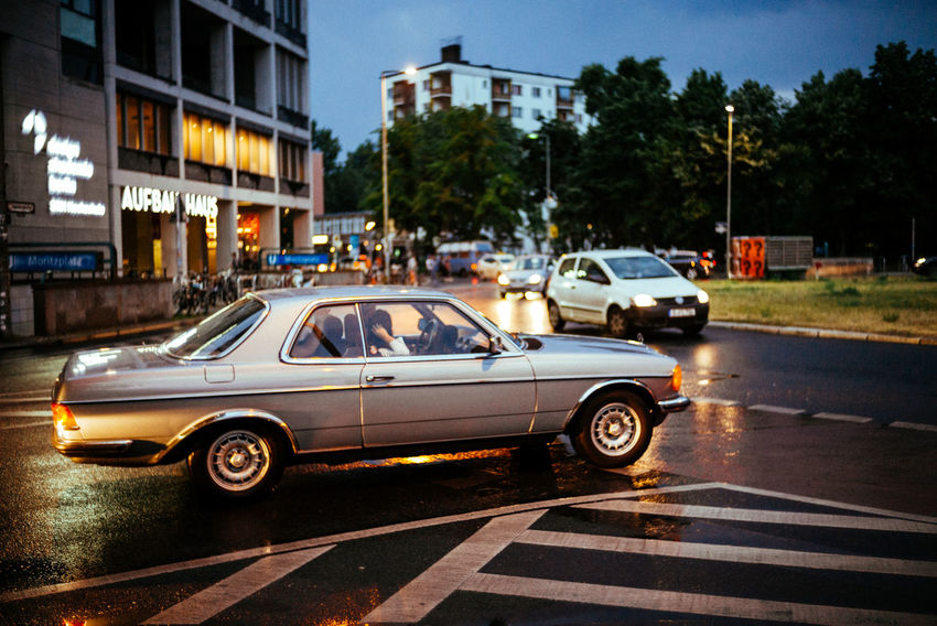 Berlin at night Lifestyle The Street Photographer - 2018 EyeEm Awards Urban Lifestyle Architecture Berliner Ansichten Building Exterior Built Structure Car City City Life City Street Illuminated Incidental People Land Vehicle Lifestyles Motion Motor Vehicle Nature on the move Outdoors Road Street Streetphotography Traffic Tree Urban