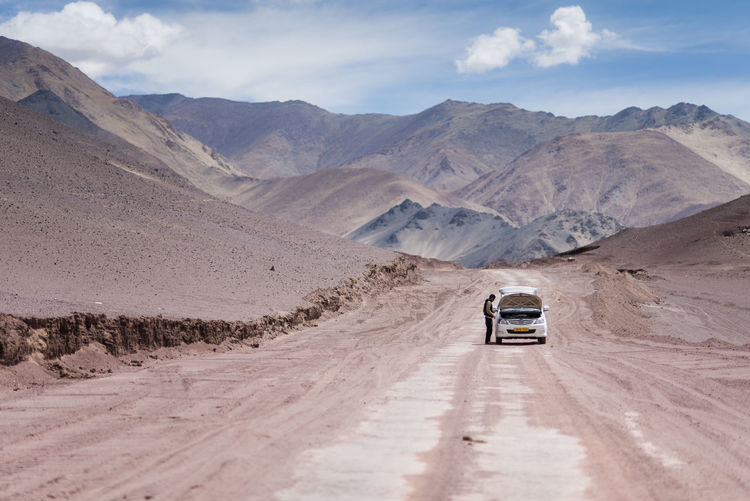 Car moving on dirt road