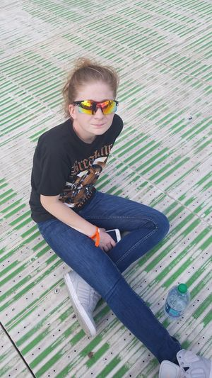 Sitting Casual Clothing Sunglasses Person Young Adult Rock N Roll Music Festival Enjoyment Green Color Resting Music Concert Festival Goer Posing Wearing Caucasian Vision