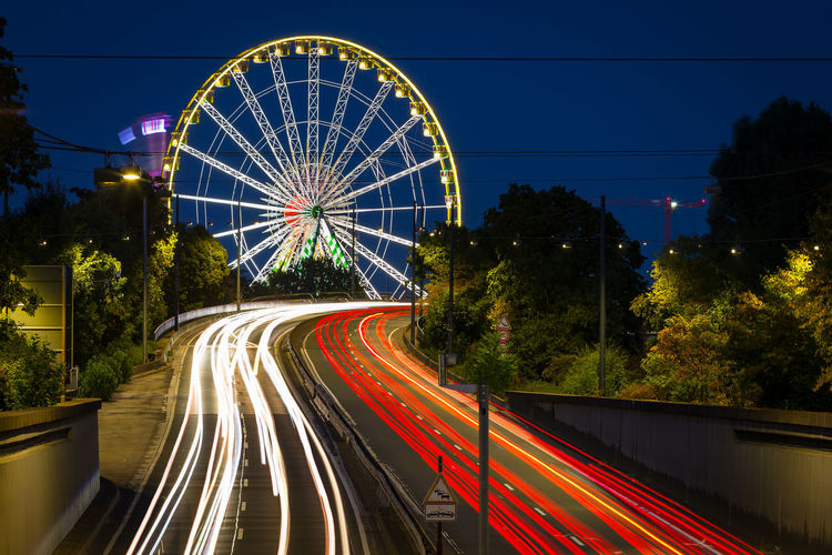 Düsseldorf, Germany Deutschland Düsseldorf Ferris Wheel Kirmes NRW Riesenrad Blurred Motion Built Structure City Glowing Illuminated Long Exposure Motion Night No People Outdoors Red Rheinkirmes Rheinkniebrücke Speed Street HUAWEI Photo Award: After Dark