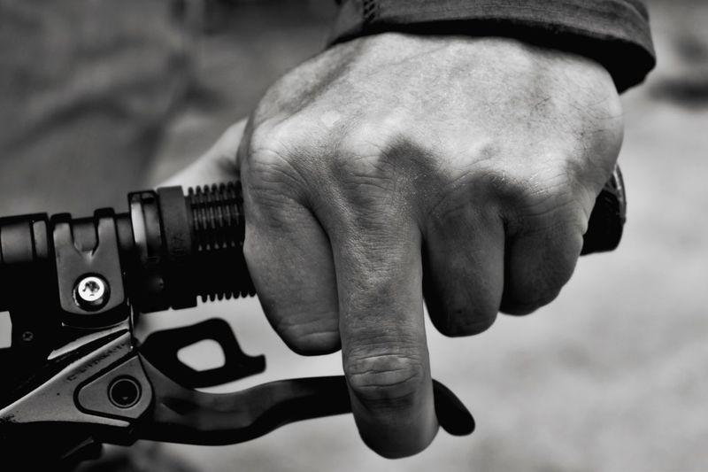 Cropped man holding handlebar of bicycle