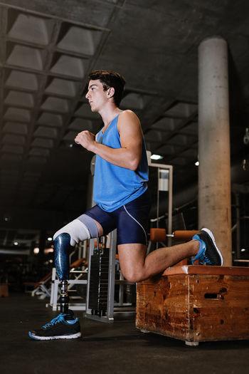 Man With Artificial Leg Exercising In Gym
