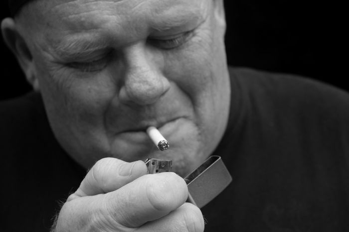 Love him. The best man I've ever known. Black And White Close-up Contrast Fire Focus On Foreground Holding Human Finger Human Portrait Human Skin Lighting Love People Person Portrait Sigarette Smile Smoke Uncle