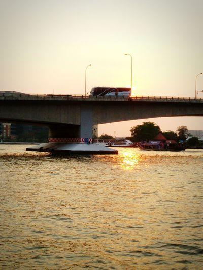 Sunlight on Chao phraya river : Somdet Phra Pin Klao Bridge, Sunset, Sundown, Dust, Riverscape, Atmosphere mood, Getting in touch, Taking photos.