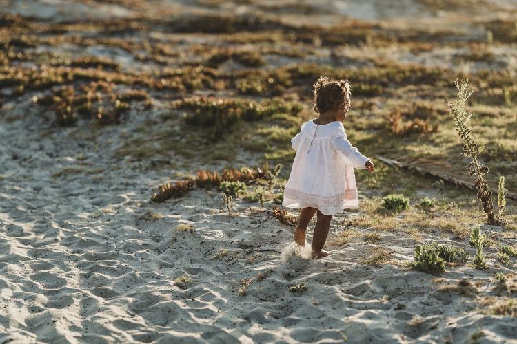 Rear view of woman walking on beach