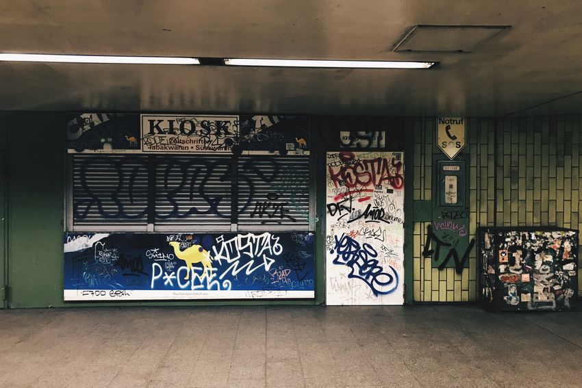The Week On EyeEm The light's still on Notes From The Underground Kiosk Graffiti Text Architecture Communication No People Abandoned Streetphotography Streetart Urbanphotography Urban Lifestyle City Life Urban Impressions Adventures In The City The Street Photographer - 2018 EyeEm Awards #urbanana: The Urban Playground