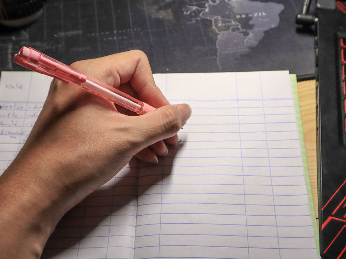 Close-up of hand holding to write note