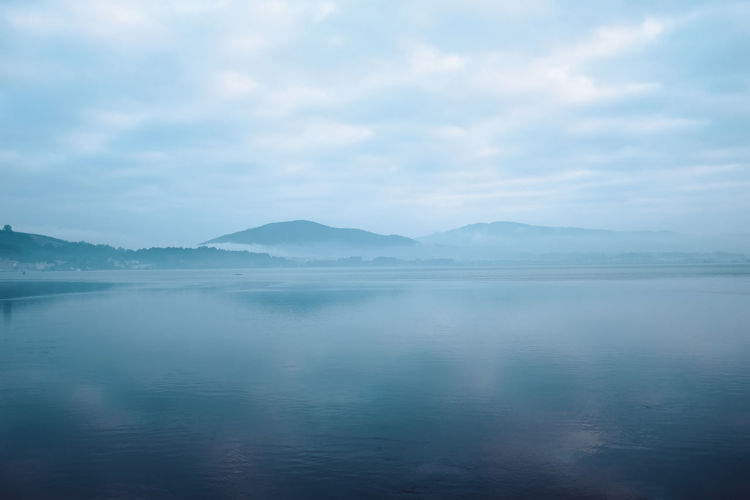 Threeweeksgalicia Water Tranquil Scene Beauty In Nature Tranquility Sky Scenics - Nature Cloud - Sky Reflection Waterfront Mountain Non-urban Scene Nature Lake Idyllic Day No People Fog Outdoors