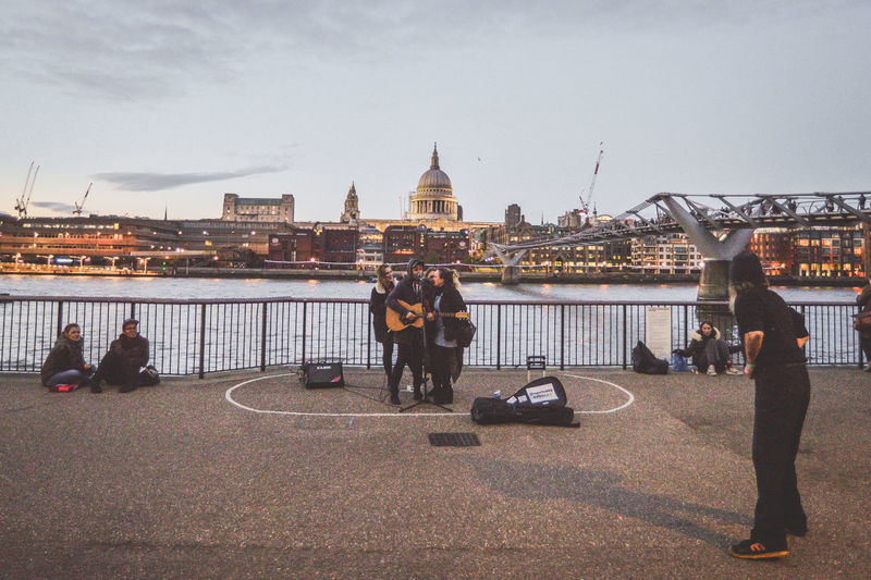 People standing on bridge in city