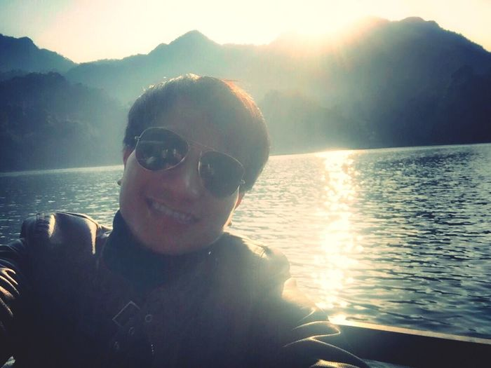 Lake Water One Person Real People Sunlight Lifestyles A New Beginning Sunglasses Sky Beauty In Nature Front View