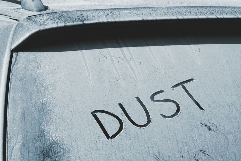Close-up of text on dirty windshield