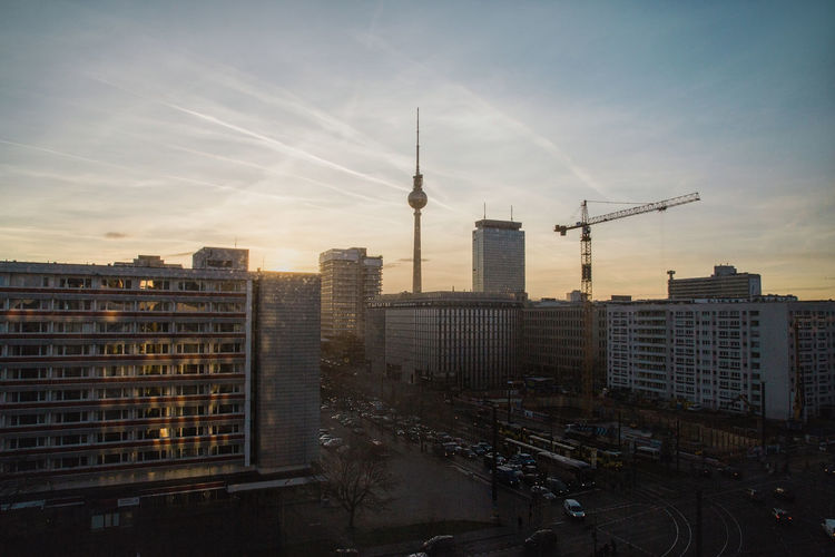 Fernsehturm Tower With Cityscape Against Sky During Sunset