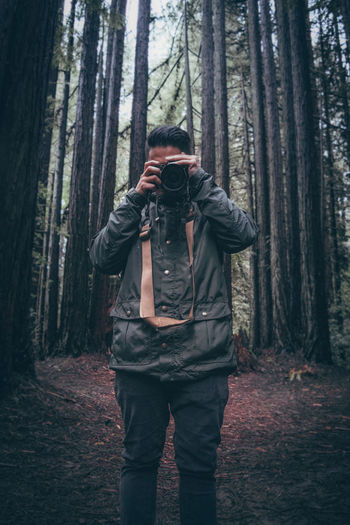 Adult Adults Only Day Forest Jacket Men Nature One Man Only One Person Only Men Outdoors People Standing Tree Tree Trunk Warm Clothing Young Adult