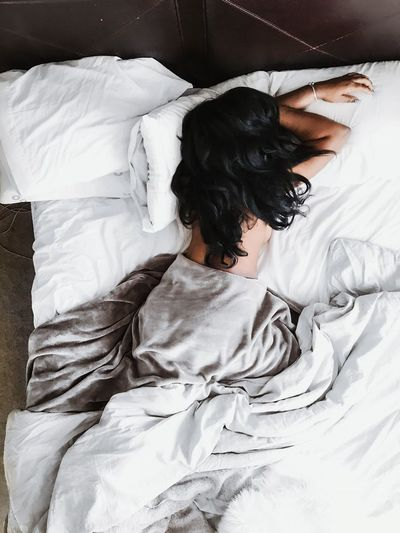 Bed Furniture Bedroom Relaxation One Person Domestic Room Indoors  Women Lying Down High Angle View Lifestyles Pillow Sheet Hair Sleeping Resting Home Interior Real People