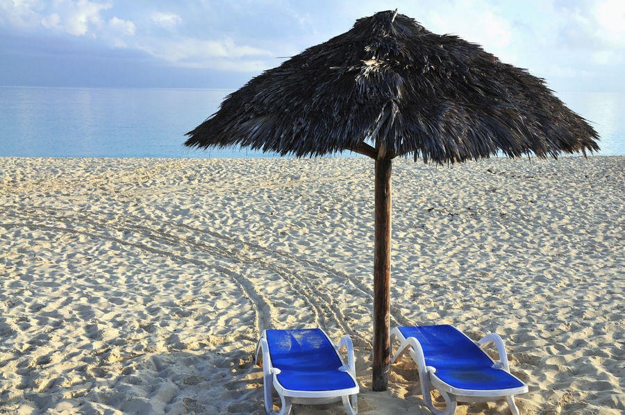 Beach Blue Brown Chair Cute Day Empty Getting Away From It All Holiday Micha D. MOVE1962 No People Part Of Relaxation Sand Sea Seat Summer Sunchair Thatched Roof Tropical Climate Vacations