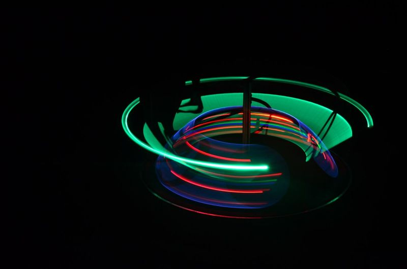Long Exposure Shot Nikon Background Background Texture Backgrounds Black Background Copy Space Creativity Dark Glowing Green Color Illuminated Light Light Painting Light Trail Lighting Equipment Long Exposure Motion Multi Colored Neon Night No People Speed Spiral