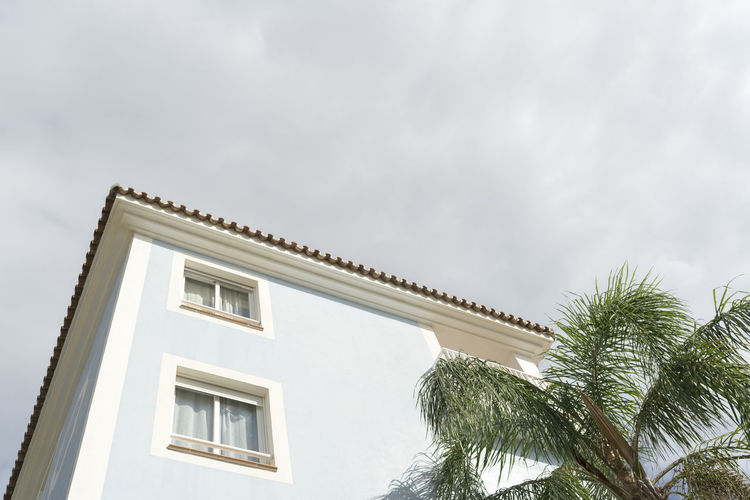 SPAIN Architecture Colours Minimalism Minimalist Architecture Building Exterior Built Structure Building Window Residential District Day Nature No People Outdoors Sky Low Angle View Cloud - Sky Tree Palm Tree Plant Tropical Climate House Growth Apartment Palm Leaf