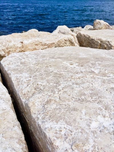 The Rock and the Sea Beach Beauty In Nature Close-up Day High Angle View Land Nature No People Outdoors Rock Rock - Object Rock Formation Sea Solid Stone Textured  Tranquil Scene Tranquility Water