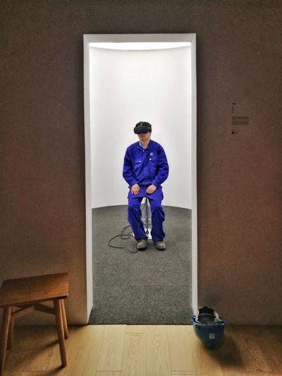 One Man Only Indoors  Adult One Person Sitting Vr Worker Comtemporary Art Experience Curiousity Prisoner Traped