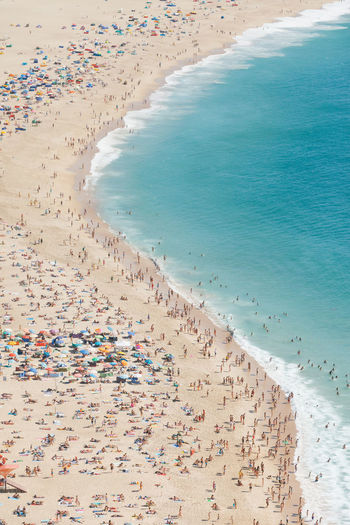 AERIAL VIEW OF CROWD ON BEACH