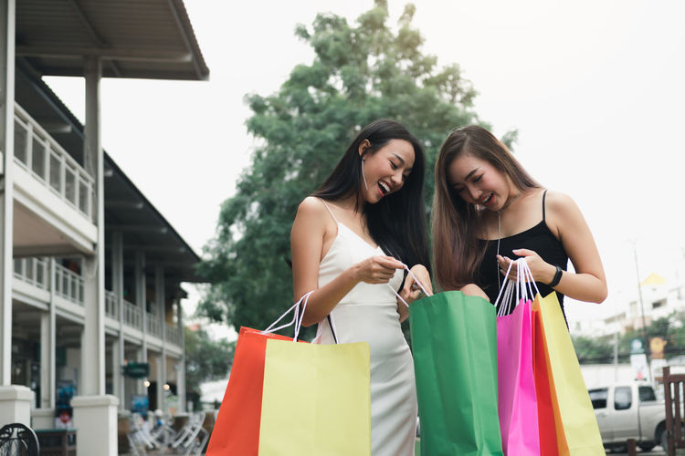 Female friends holding shopping bags
