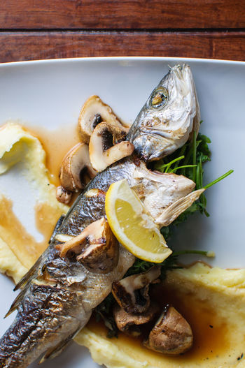 Sea bass with mushrooms Close-up Fish Food Gourmet Lemon Mushroom No People Plate Ready-to-eat See Bass