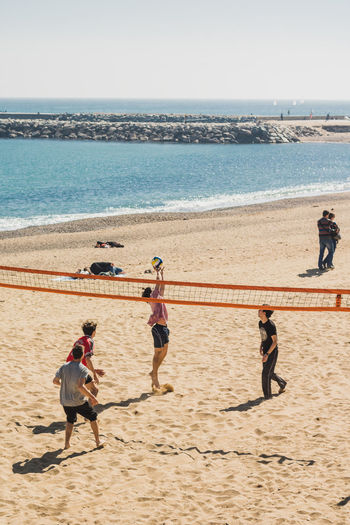 Sea Beach Water Sand Horizon Over Water Real People Outdoors Sunlight Nature Summer Day Men Sky Beauty In Nature People Adult Occupation Only Men Adults Only Beach Photography Portrait Of A City Barcelona Beach Volleyball Young Adult Team