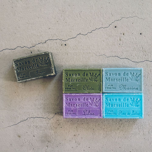 Bar of multi colored soaps on cracked floor