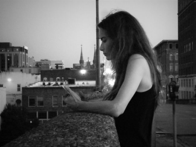 sometimes she gets moody Architecture Building Exterior Building Terrace Built Structure Candid Casual Clothing City City Life Clear Sky Contemplation Domestic Life Focus On Foreground Holding Leisure Activity Lifestyles Long Hair Person Relaxation Sky Terrace Young Adult Young Women