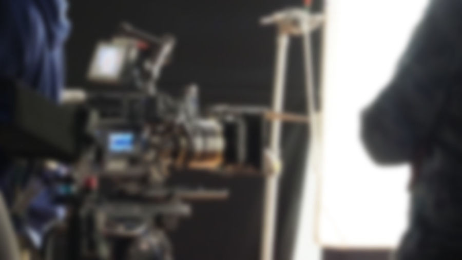 Blurry images of studio video shooting behind the scene or b-roll for online commercial and tvc which done by professional movie director film crew team and camera equipment with lighting set Indoors  Selective Focus Close-up One Person Technology Real People Focus On Foreground Occupation Portrait Arts Culture And Entertainment Headshot Rear View Adult Young Adult Men Machinery Studio Lifestyles Human Body Part Filming Video; Camera; Production; Film; Shoot; Studio; Movie; Professional; People; Equipment; Shooting; Background; Man; Tv; Digital; Work; Media; Behind; Interview; Industry; Operator; Maker; White; Television; News; Director; Cinema; Scene; Record; Broadcast;