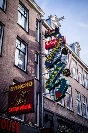 Coffee, steak and Internet Amsterdam Coffee Shop Shop Sign Restaurant Sign Amsterdam Streets Steakhouse Text Communication Neon Building Exterior Architecture Low Angle View Travel Destinations Illuminated City