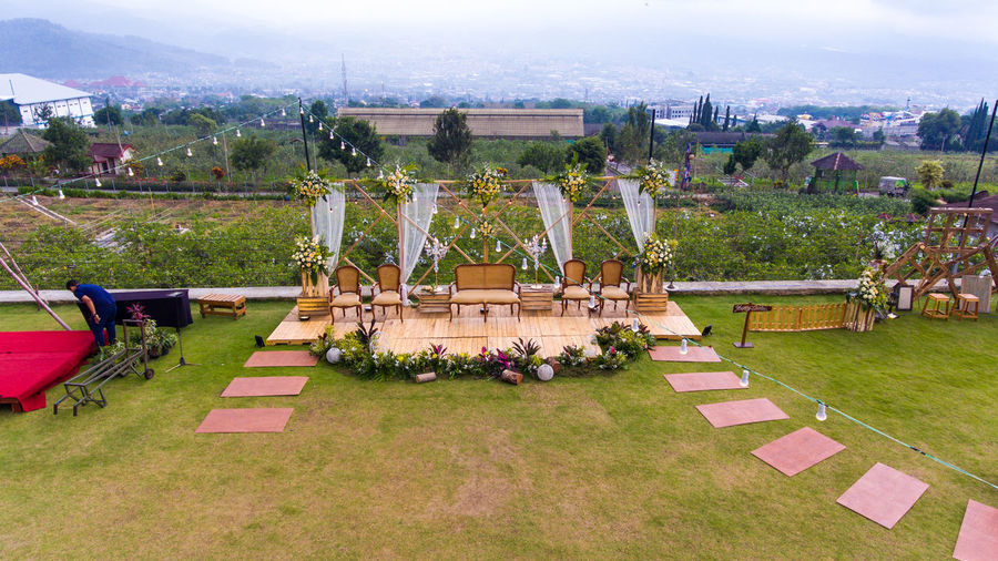 outdoor wedding stage decoration Plant Nature Tree High Angle View Grass Day Architecture Building Exterior No People City Sky Built Structure Outdoors Cloud - Sky Field Travel Destinations Lawn Environment Landscape Wedding Wedding Dress Wedding Photography Wedding Ceremony Wedding Day