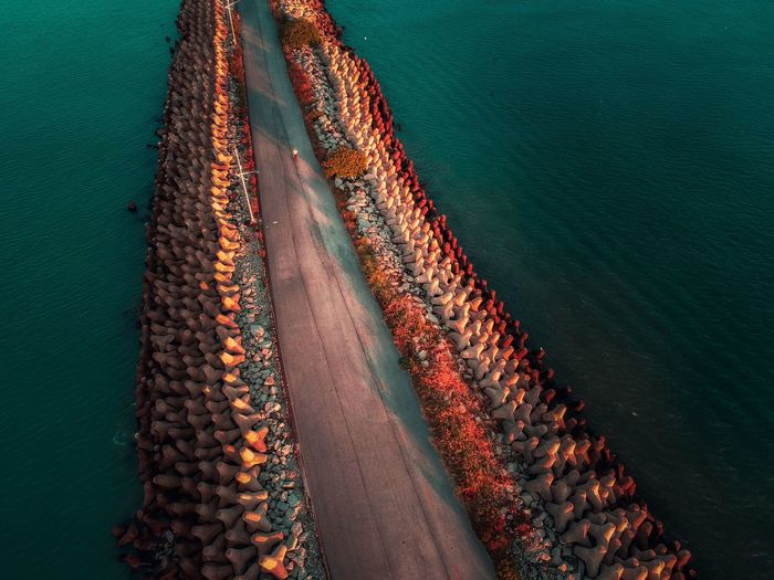High angle view of pier in sea during sunset