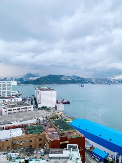 Rain is coming Hong Kong Port Tugboat Cloudy Stormy Weather Storm Harbour Shore Sea Warehouse Cloud - Sky Water Sky Architecture Building Exterior Sea Built Structure Nature City High Angle View Building Outdoors No People