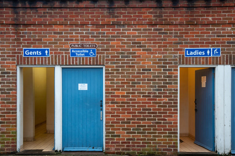 Public Toilets, Ladies, Gents and Accessible toilets with blue wooden doors in an old red brick building. Accessible Toilets Dorest England Gents Ladies Weymoth Baby Changing Blue Blue Signs Brick Wall Coastal Town Council Council Run Jurassic Coast Old Style Public Conveniences Public Toilets Red Bricks South Coast Toilets Wood Doors Architecture Built Structure Brick Door Entrance Wall Wall - Building Feature Sign Building Exterior Western Script Text Communication No People Building Closed Day Absence Guidance Message