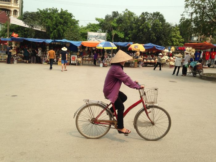 Woman on a bicycle Travel Photography Bicycle City Crowd Land Vehicle Leisure Activity Lifestyles Outdoors People Protection Riding Street Transportation Umbrella Women Bicycle City Crowd Land Vehicle Leisure Activity Lifestyles Outdoors People Protection Riding Street Transportation Umbrella Women My Best Travel Photo