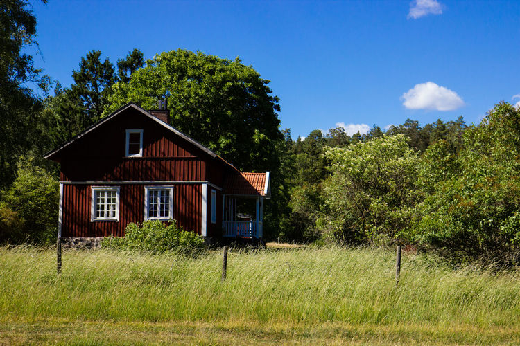 Sweden Swedish Architecture Building Building Exterior Built Structure Cottage Grass Green Color House Landscape Outdoors Red House Rural Scene Swedish House Swedish Summer Tree