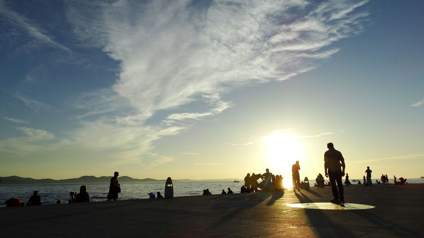 Summer In The City Beach Beauty In Nature Crowd Group Of People Holiday Land Large Group Of People Leisure Activity Lifestyles Men Nature Outdoors Real People Scenics - Nature Sea Sky Sun Sunset Water