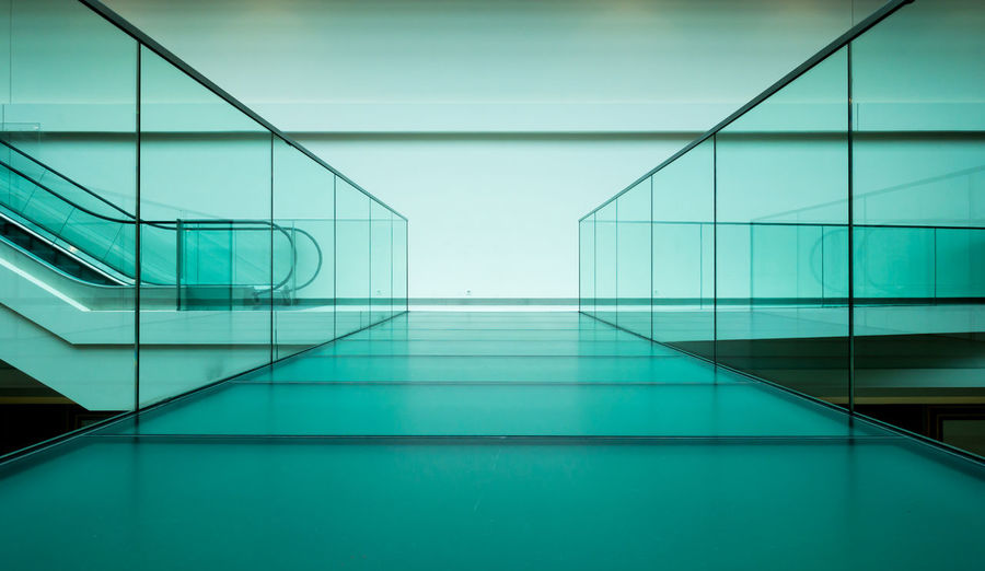 Architecture Bridge Built Structure Day Escalator Glass Glass - Material Illuminated Indoors  Lines Minimalism Minimalistic Modern No People Pedestrian Reflection Transparent Turquoise Walkway The Architect - 2018 EyeEm Awards Corridor Arcade Turquoise Colored Business Reflection Flooring Entrance Pattern Futuristic Building