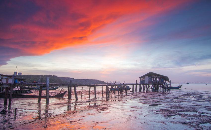Sunrise at jetty in Penang Island Sky Water Built Structure Sea Architecture Cloud - Sky Sunset Beach Scenics - Nature Beauty In Nature Stilt House Building Tranquil Scene Tranquility Building Exterior Nature Land House Stilt No People Outdoors Jetty