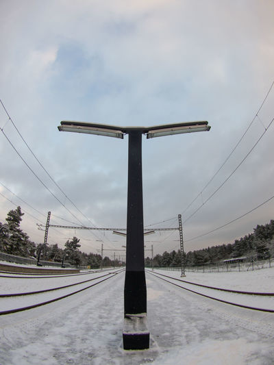 Built Environment Cloud - Sky Cold Temperature Day Fisheye Infrastructure Life In Cold Climate No People No Train Outdoors Pääsküla Snow Snow ❄ Train Station Winter