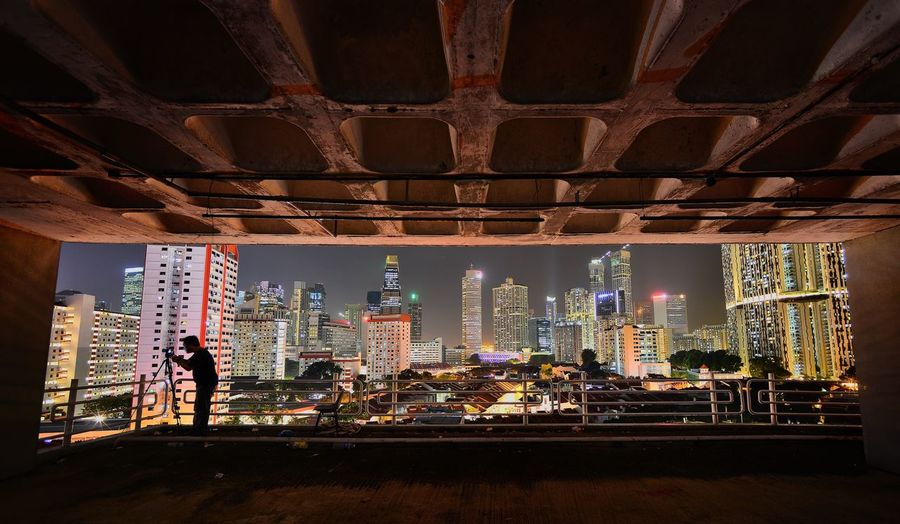 Photographer In Singapore At Night