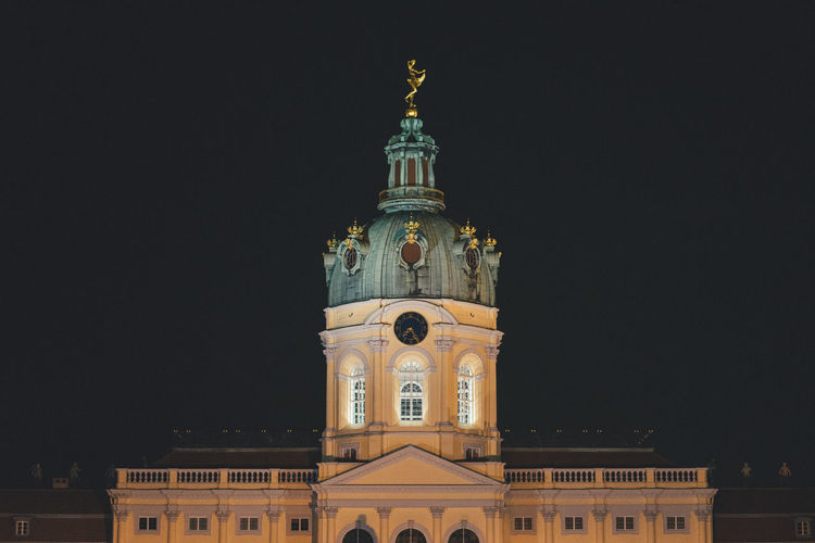 Berlin cathedral against sky at night