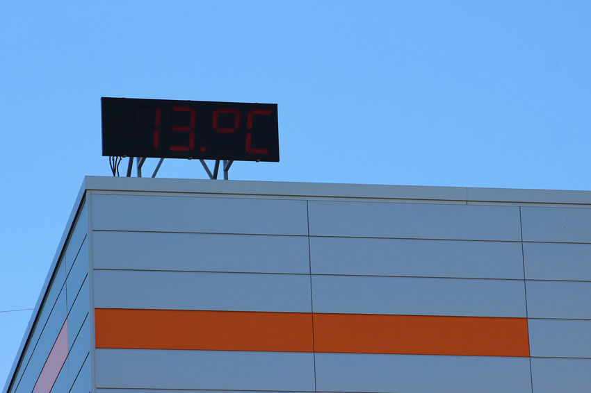 Architectural Detail Architectural Feature Architecture Blue Blue Sky Building Building Exterior Celsius Clear Sky Copy Space Day Digital Gray Low Angle View Numbers Orange Color Outdoors Red Silhouette Temperature Thirteen Water Tank