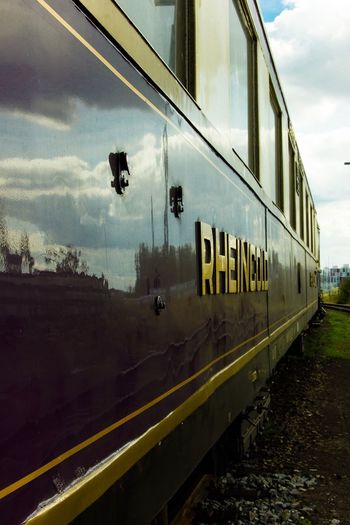 RheinGold Train Railway EyeEm Best Shots EyeEm Selects EyeEm Gallery Sky Cloud - Sky Transportation Rail Transportation Train Mode Of Transportation Public Transportation Architecture Window Railroad Track Reflection Glass - Material Built Structure No People Nature Track Travel Train - Vehicle Day Outdoors