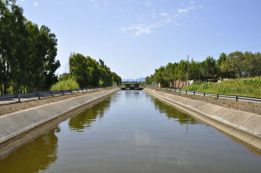 Sardinia Water Reflection Tree Sky Day Cloud - Sky Reflecting Pool Outdoors No People Nature Irrigation Equipment City Politics And Government Summer Mediterranean  Channel Drainage Channel River