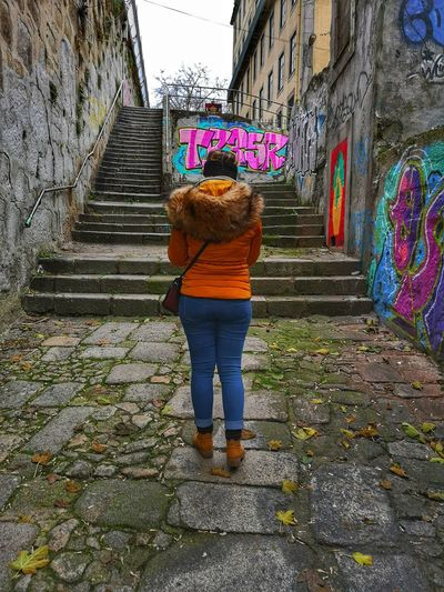 Women Full Length Standing Multi Colored Rear View Architecture Building Exterior Built Structure Casual Clothing Sky Graffiti Street Art Stairs