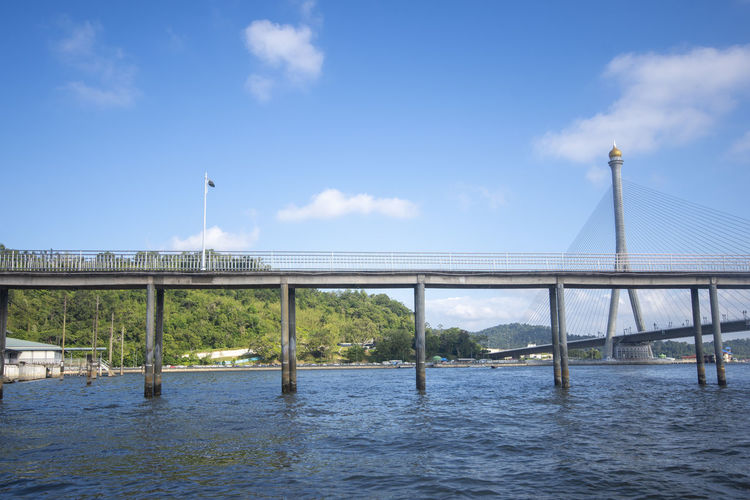 Bridge at Kampong Ayer, Brunei Darussalam Built Structure Architecture Sky Water Cloud - Sky Bridge Bridge - Man Made Structure Connection Transportation River Nature Day Building Exterior No People City Travel Destinations Outdoors Waterfront