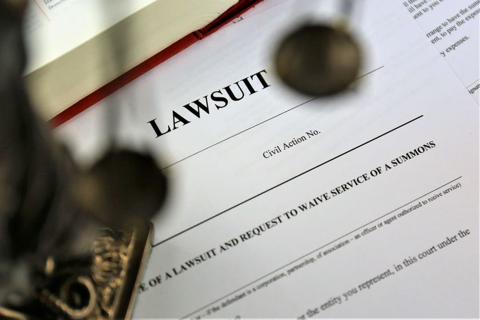 An concept Image of a lawsuit Business Court Justice - Concept Office Work Civil Close-up Concept Day Indoors  Justice Law Lawsuit Legal License Paper Text
